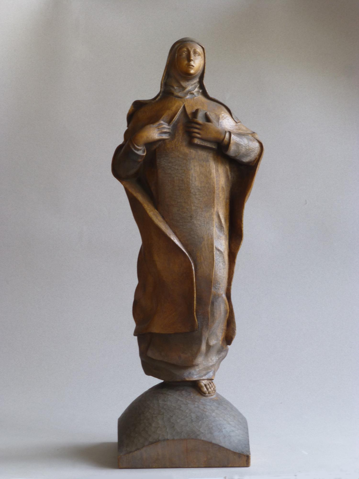 1953.2. Santa Teresa, boceto en madera de nogal, 53x20x09 cms. Boceto de la figura monumental para la fachada de la Iglesia de Santa Teresa y Santa Isabel en Madrid. 1953