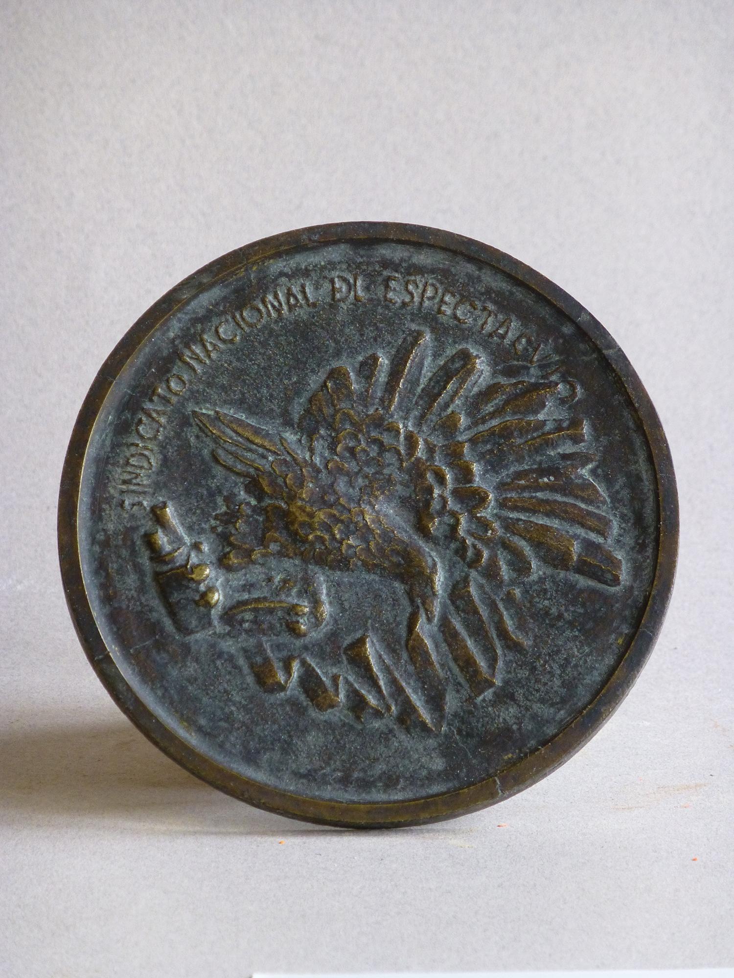 1953.3. Águila, Medalla, bronce, 9x0,2 cms. Premio Cinematográfico, Sindicato Nacional del Espectáculo. 1953