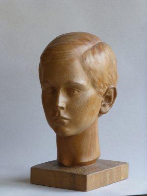 1980.2. Cabeza de su nieto Jaime, madera, cemento. 1980