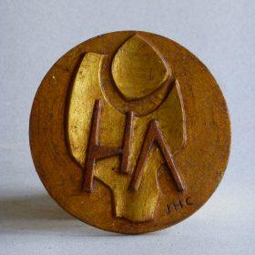 1998.3. Medalla de Higueras Arte, resina, 9x0,4 cms. 1998